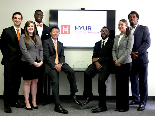 The workers of Hyur Staffing Services. (left to right): Andrew Galyan-Mann, recruiter; Emily Gamble, recruiting assistant; Ebow Vroom, president; Chris Beatty, senior vice president; Ernest Duncan, field supervisor; Danyette Foulks-Young, senior recruiter; Dhani Jones, chief executive officer